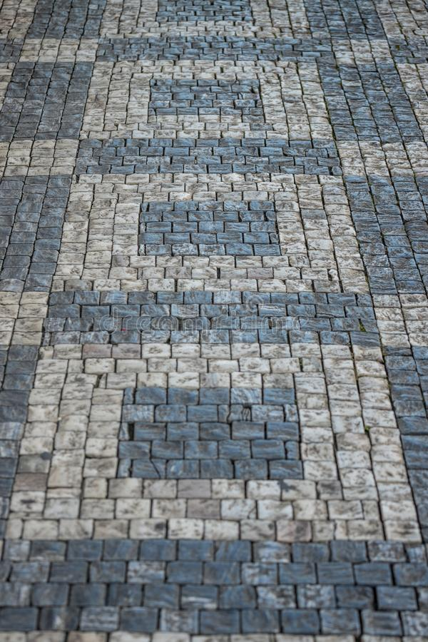 Darker and brighter cobble stones placed in geometric pattern in Prague old town.  royalty free stock photos