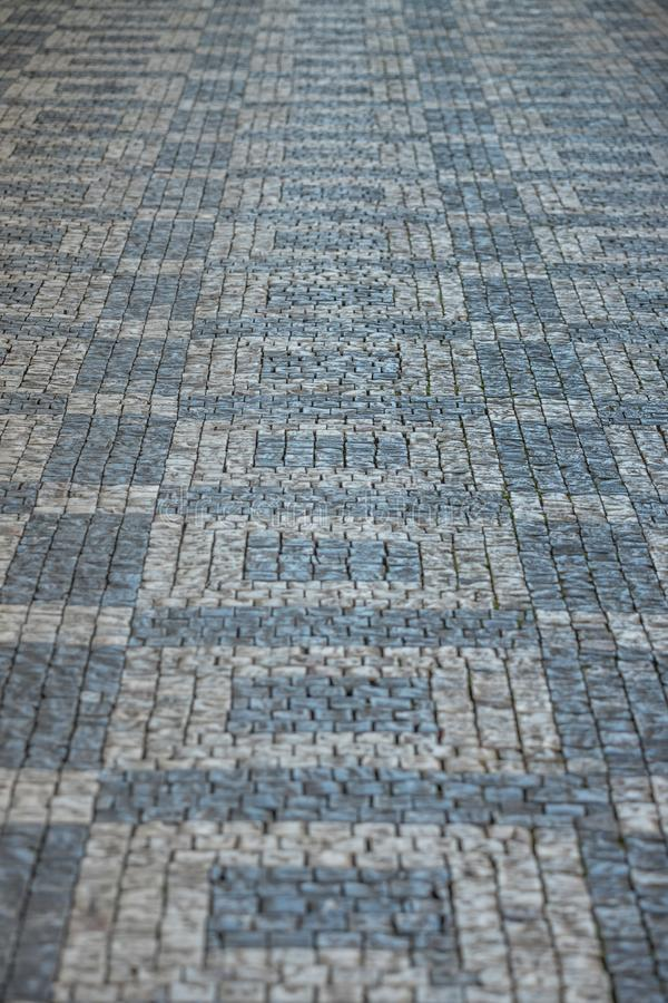 Darker and brighter cobble stones placed in geometric pattern in Prague old town.  stock photography