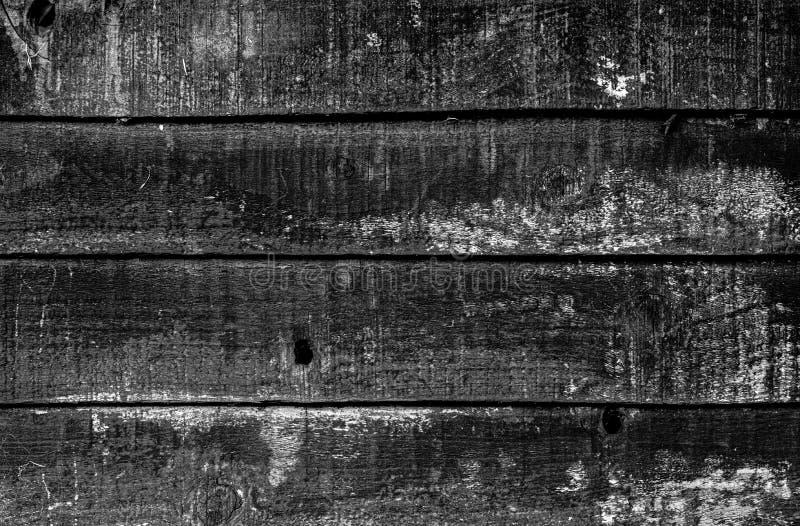 4 dark Grayscale horizontal wooden stripe. 4 darker shaded Grayscale horizontal wooden stripe with a grunge effect stock image