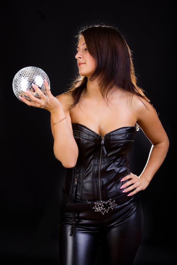 darkhaired sexig discoballkvinnlig arkivfoton
