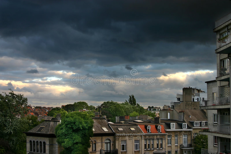 Heavy rain clouds over city stock images