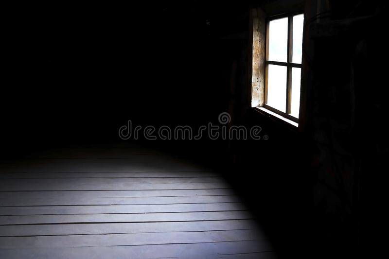 Darkness and horror, background with copy space. Inside in an empty dark room of an old abandoned house with black walls mystical stock image