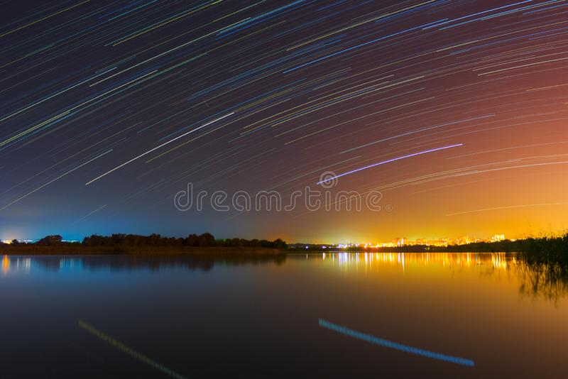 Colorful night photography. Long exposure photography of starry sky and night city royalty free stock photography