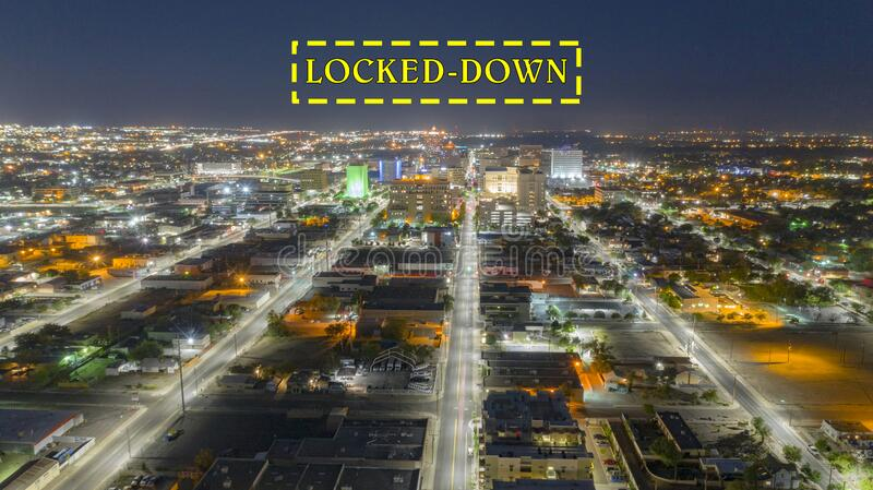 Darkness Before Sunrise Aerial Perspective Downtown City Skyline Albuquerque New Mexico. Illuminated streets lead travelers into Albuquerque New Mexico before royalty free stock image