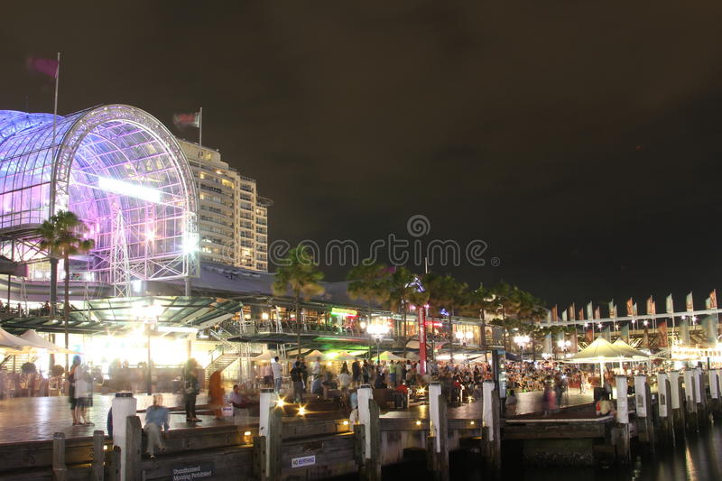 Darling Harbour bustling night scene. Night shot showing the bustling atmosphere at the Harbourside shopping centre of Darling Harbour in Sydney, Australia, by a royalty free stock photos