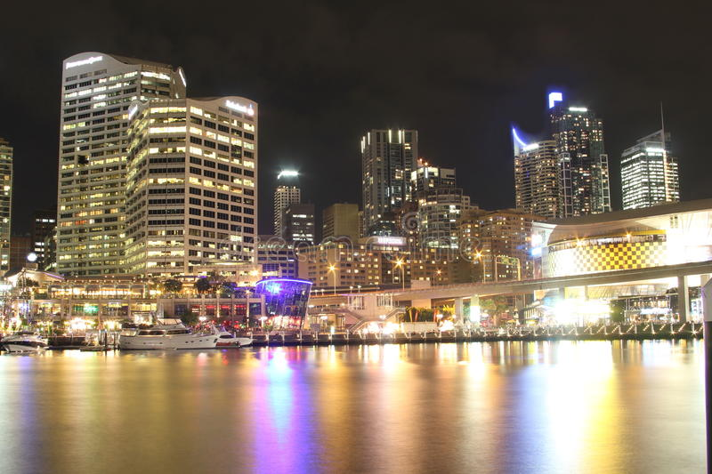 Darling Harbour cityscape at night. Looking across Darling Harbour in Sydney, Australia, at a clear night to Imax, Cockle Bay Wharf and Sydney downtown buildings royalty free stock image