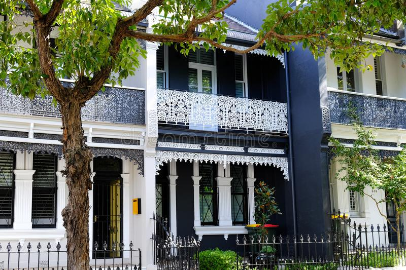 Darlinghurst Terrace Houses, Sydney, NSW, Australia. Well maintained old terrace, or row, houses with iron lace balconies, in a quiet leafy street in stock images