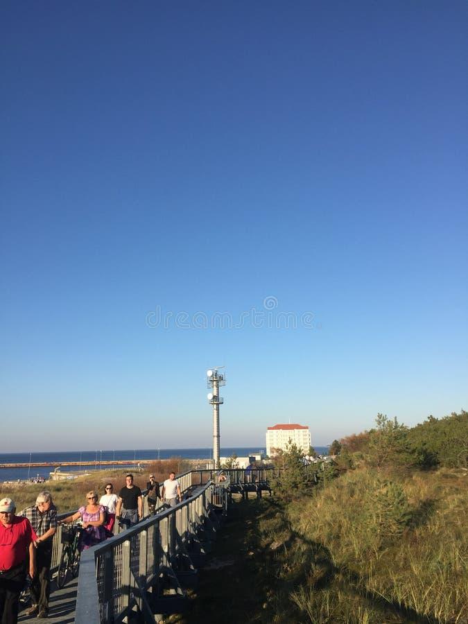 Darlowo Poland: dune walkway with tourists stock image