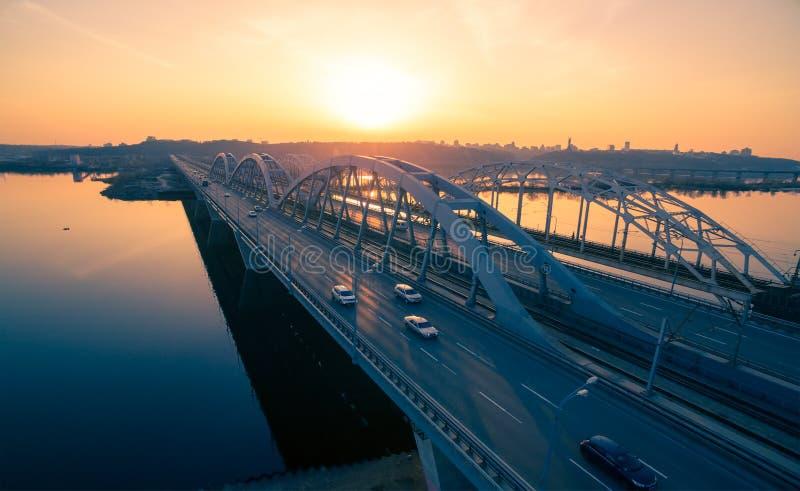 Darnitskiy bridge at sunset. Darnitskiy bridge across Dnepr river against sunset sky. Kiev, Ukraine stock images