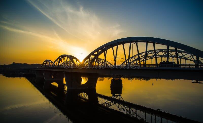 Darnitskiy bridge at sunset. Darnitskiy bridge across Dnepr river against sunset sky. Kiev, Ukraine stock image