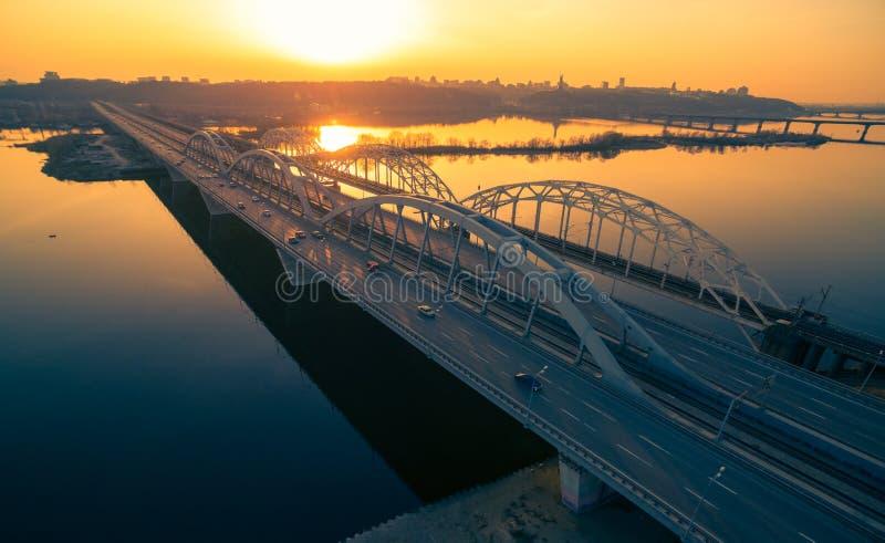 Darnitskiy bridge at sunset. Darnitskiy bridge across Dnepr river against sunset sky. Kiev, Ukraine stock photo