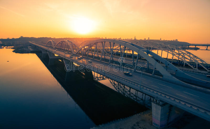 Darnitskiy bridge at sunset. Darnitskiy bridge across Dnepr river against sunset sky. Kiev, Ukraine royalty free stock photo