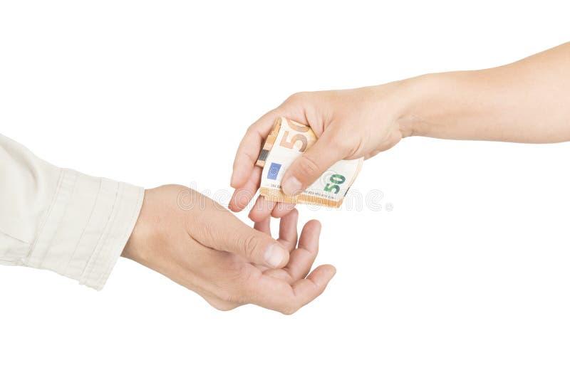 Darowizna pieniężna Dłoń kobiet z banknotami euro daje je innym fotografia royalty free