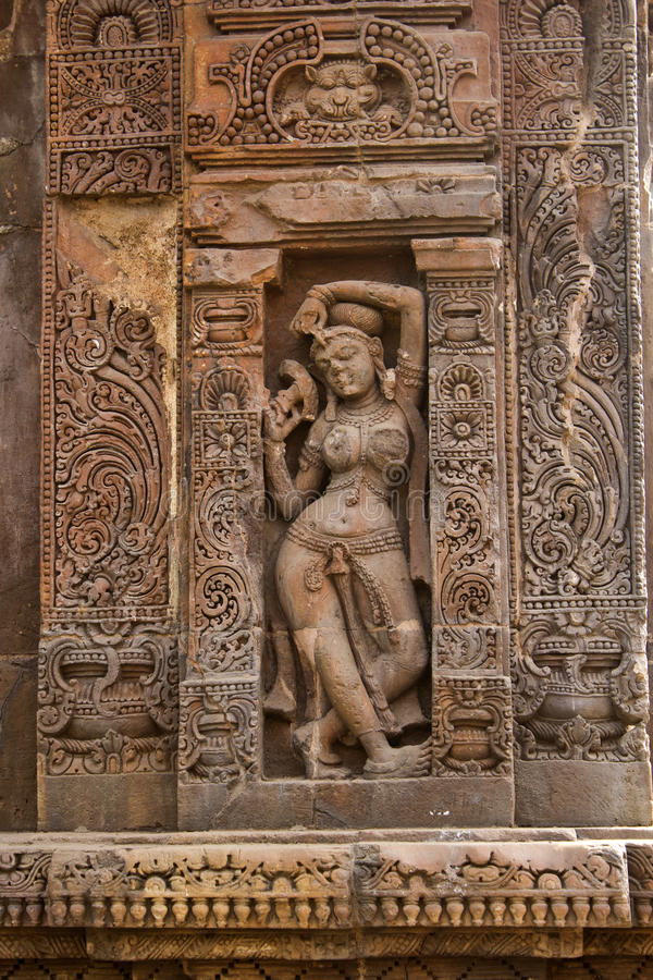 Darpana sundari. Or Beauty with mirror on the wall of the famous temple Vaital Deul in Bhubaneshwar royalty free stock photos