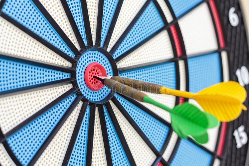 Dart arrows in target center. Business, strategy and sucess concept.  stock photos