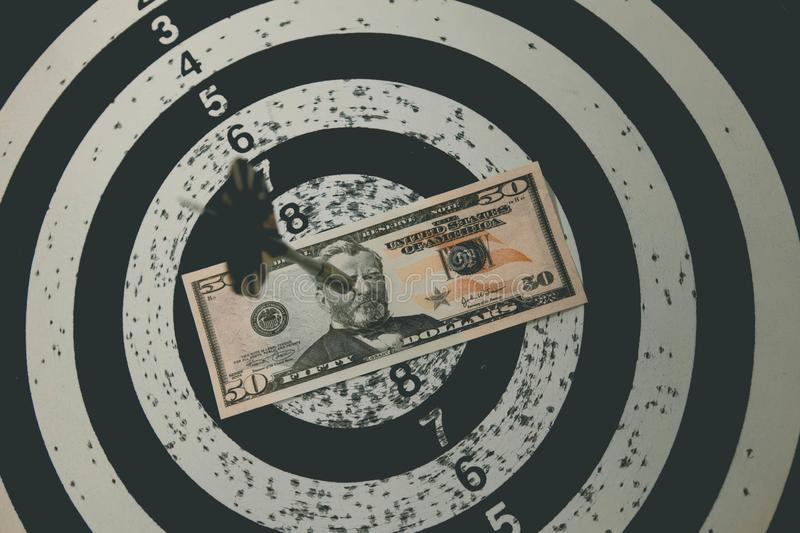 Dart board with darts on target with your money. Dart board with darts on target with your money stock image