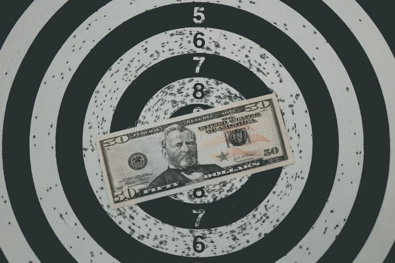 Dart board with darts on target with your money. Dart board with darts on target with your money stock photography