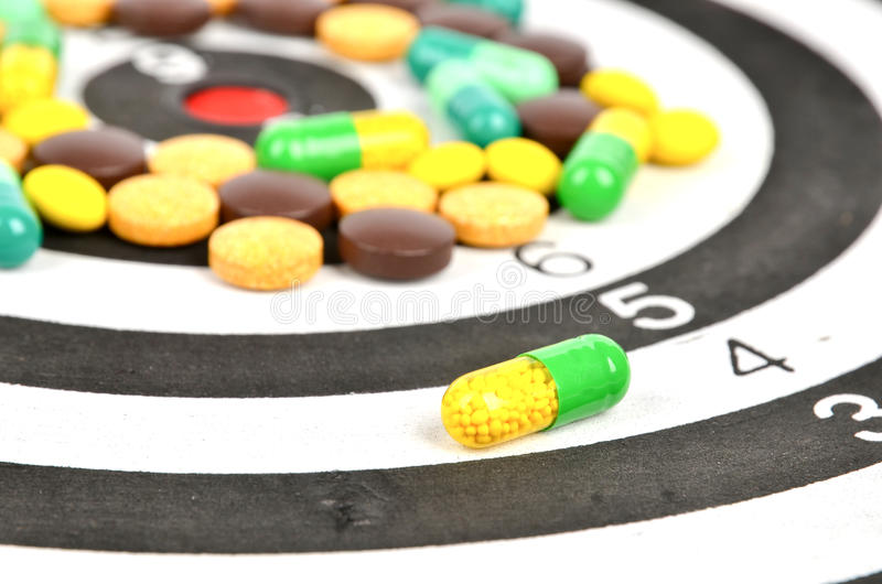Dart board and medicine stock photo