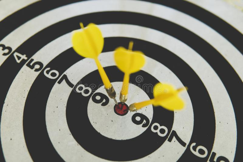 dart on board right direction hit target goal. Competition game to win focus on achievement with smart thinking planning accurate stock photo