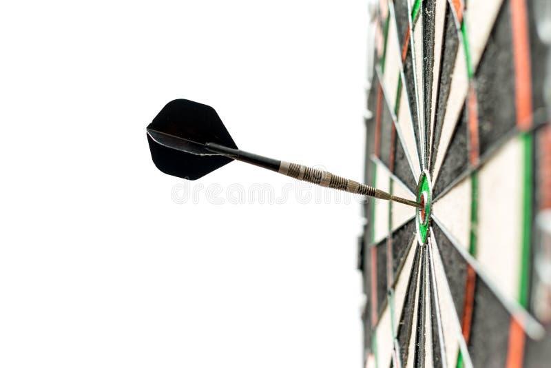 Dart in bulls-eye stock image