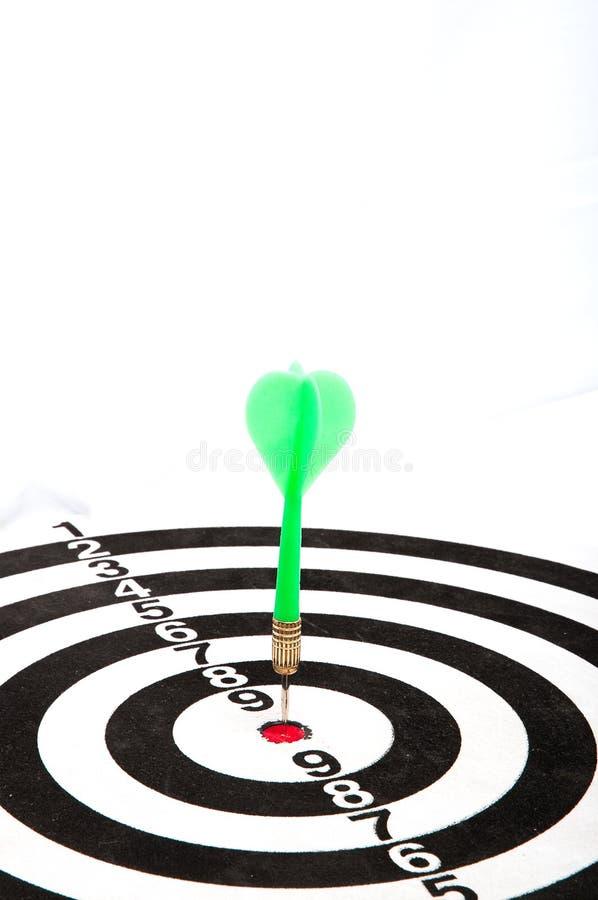 Dart in bullseye of dartboard stock photo