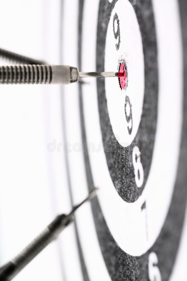 The dart game sticks out in the center of the red royalty free stock photos