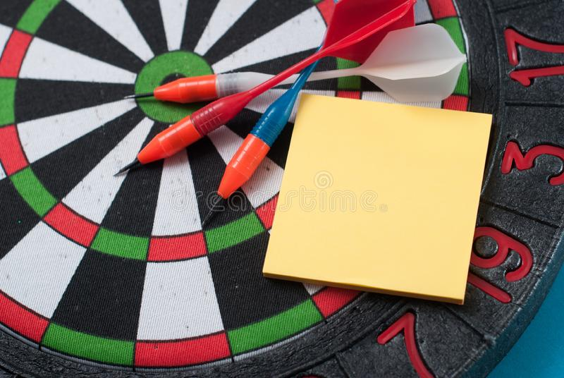 Dart hit the center of the target and attaches the sticker, stock photography