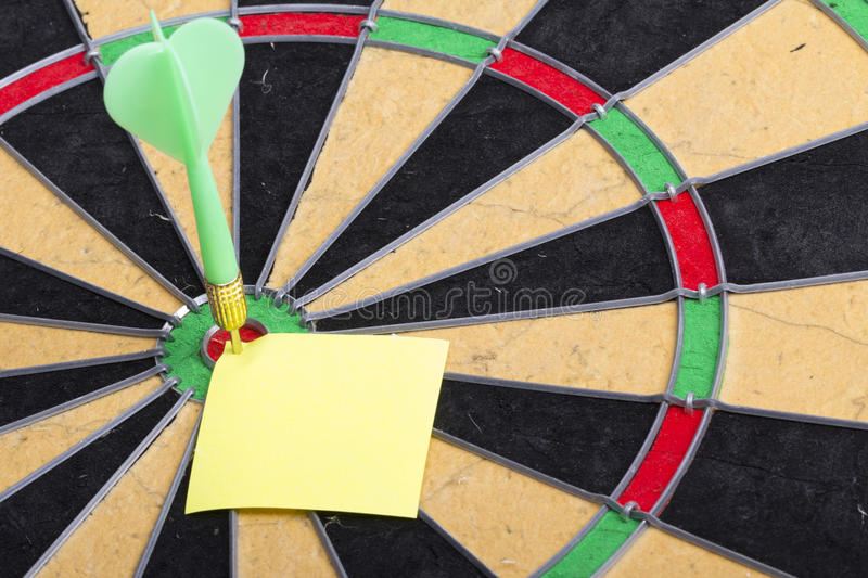 Dart hit the centre of target royalty free stock photo
