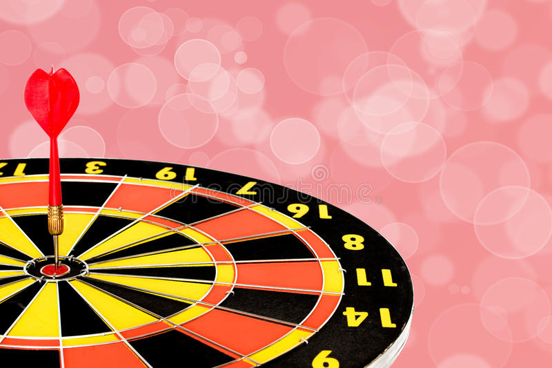 Download Dart Target Board With Abstract Bokeh Background Stock Photo - Image: 83709277