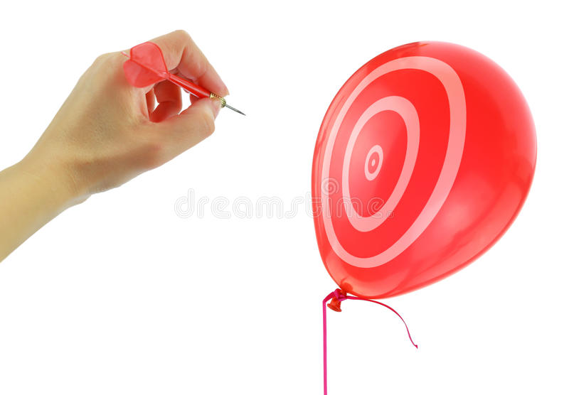 Dart about to pop a balloon. Isolated on white royalty free stock images