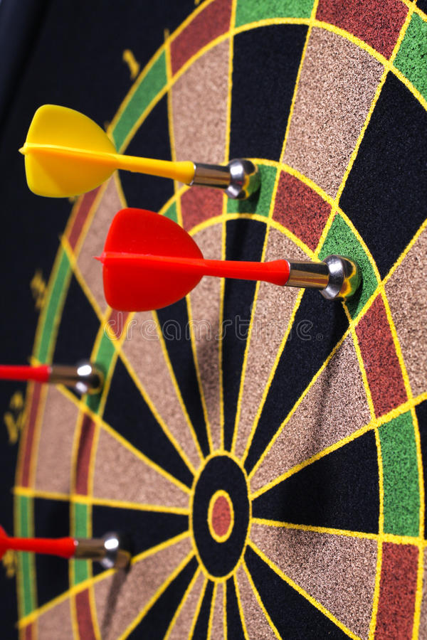 Dartboard. Closeup of a dartboard with yellow and red magnetic darts stock images