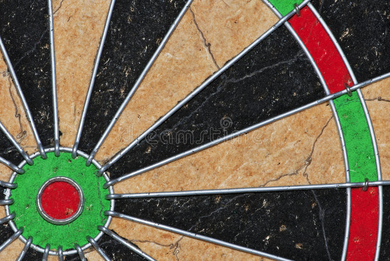 Dartboard. An off-centre shot of a dartboard showing the bull (centre) and some of the triple point spaces royalty free stock photography