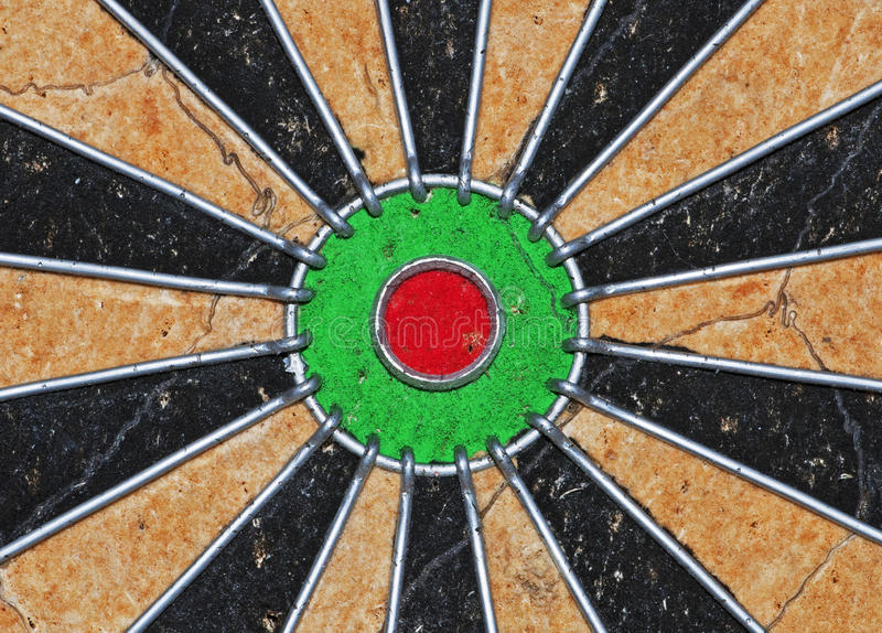 Dartboard. An centre shot of a dartboard showing the bull (centre) and the other point spaces radiating away from the centre stock photo
