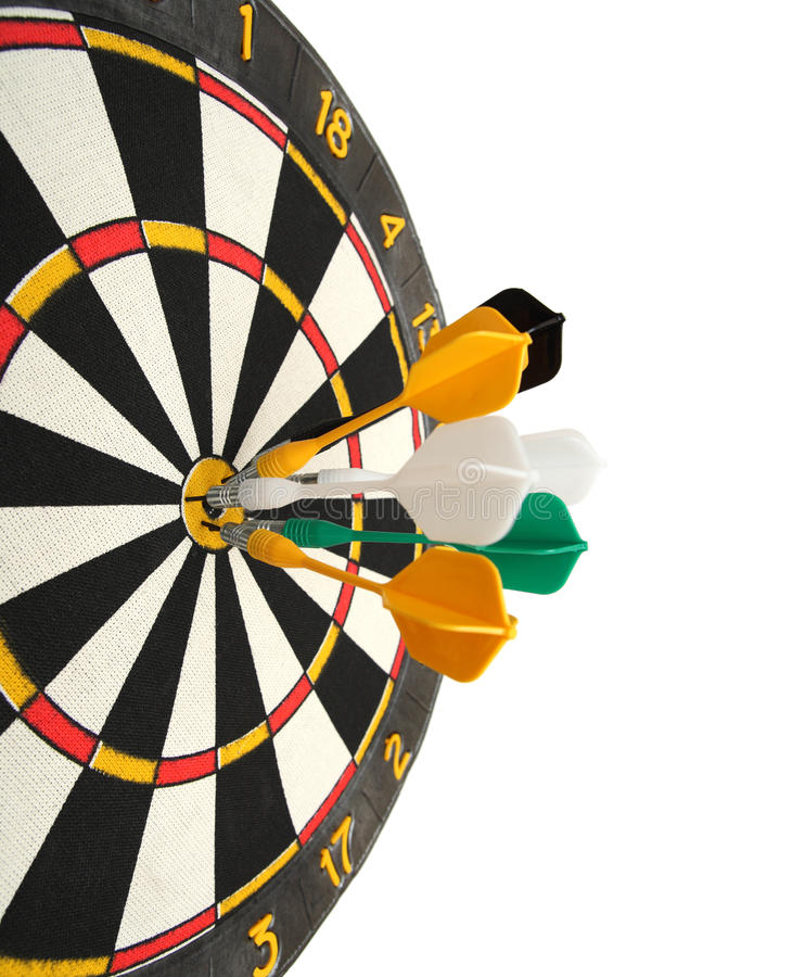 Dartboard with darts in aim. Isolated on white stock photography