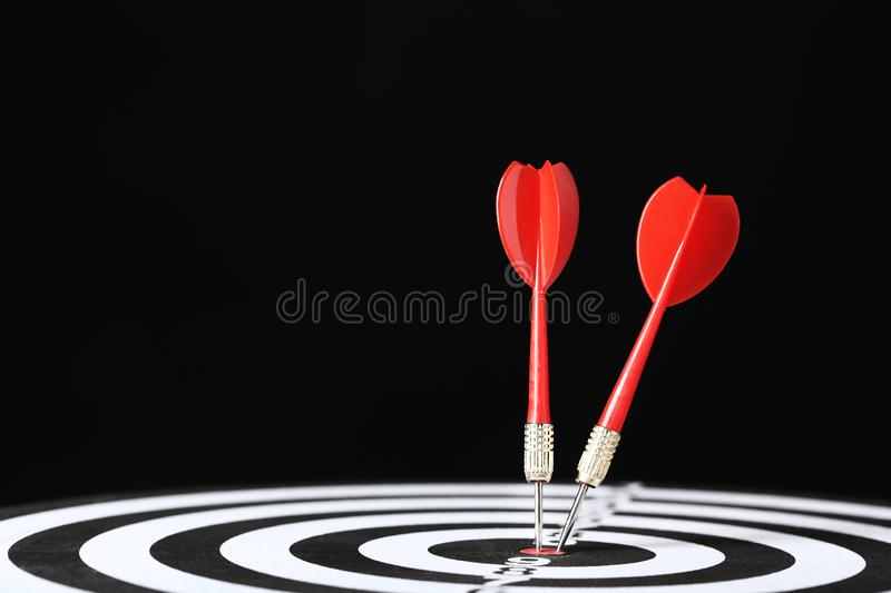 Dartboard with darts. On black background royalty free stock photos
