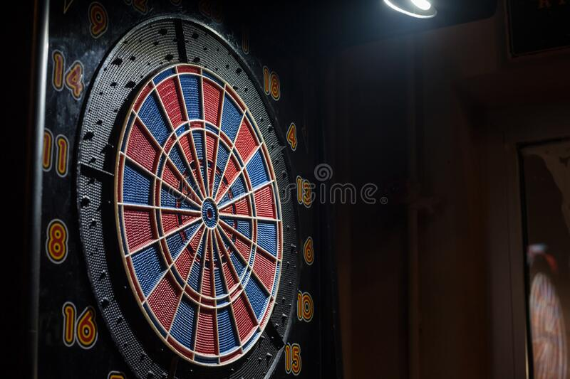 Dartboard, a darts target blue and red with its bulls eye used for practicing arrows. stock photography