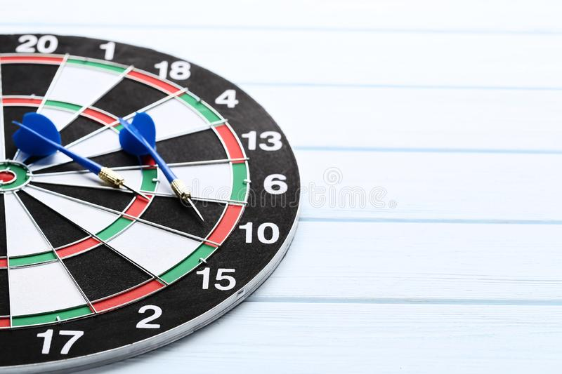 Dartboard with darts. On wooden table stock image