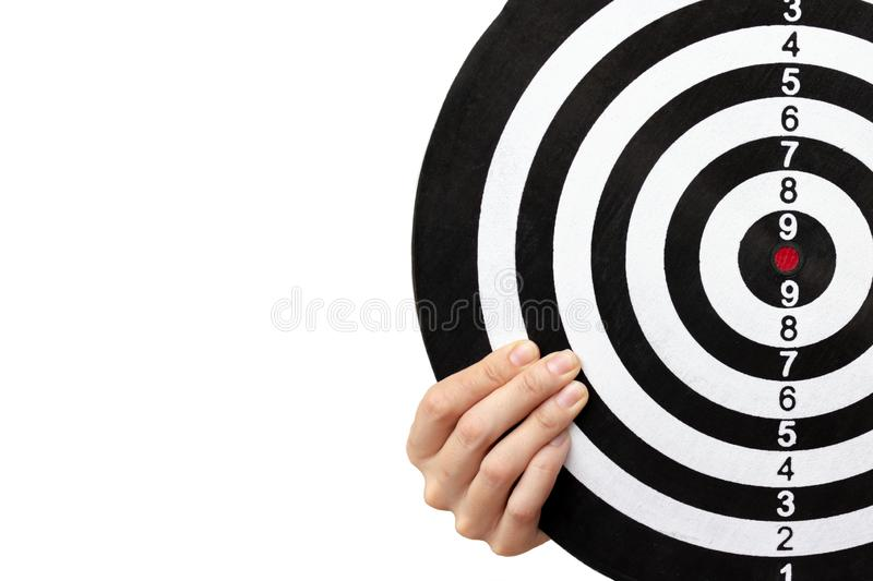 A dartboard in female hands close up on white background with copy space, aiming and targetting concept royalty free stock images