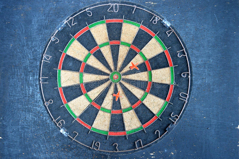 Dartboard. On old wood wall, selective focus stock image