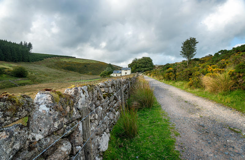 Dartmoor National Park. Country lane leading to Wistman's Wood at Two Bridges on Dartmoor National Park in Devon royalty free stock photography