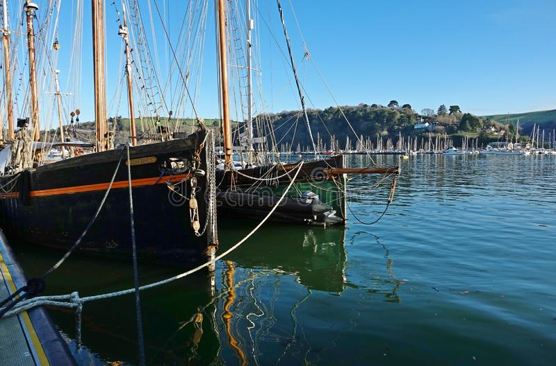 Dartmouth Harbour England. Two bows of vintage fishing vessels moored in the harbour. Dartmouth England.  Two vintage fishing vessels moored in the marina on the royalty free stock photography