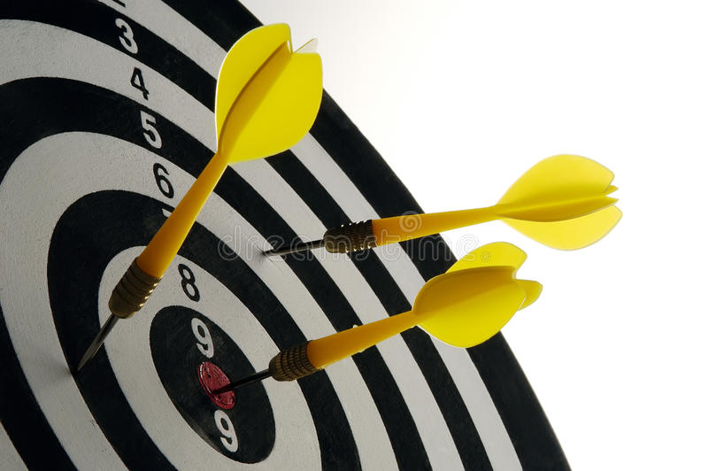 Darts. Throwing darts at a target on a white background stock photography