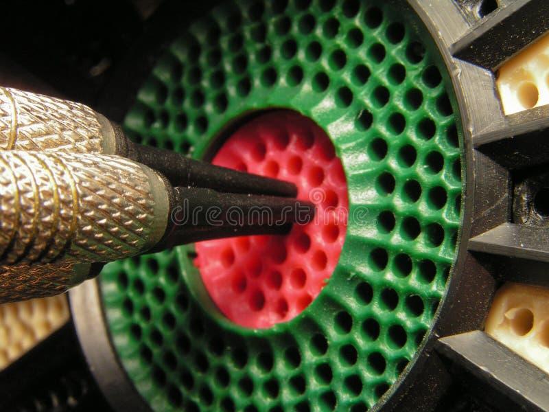 Darts. Three darts in the bull-eye of target stock image