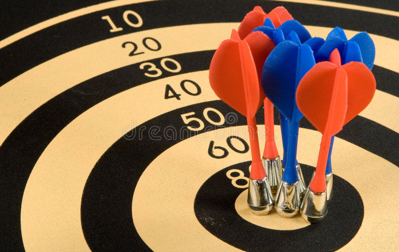 Darts. Magnetic darts in a target stock photos
