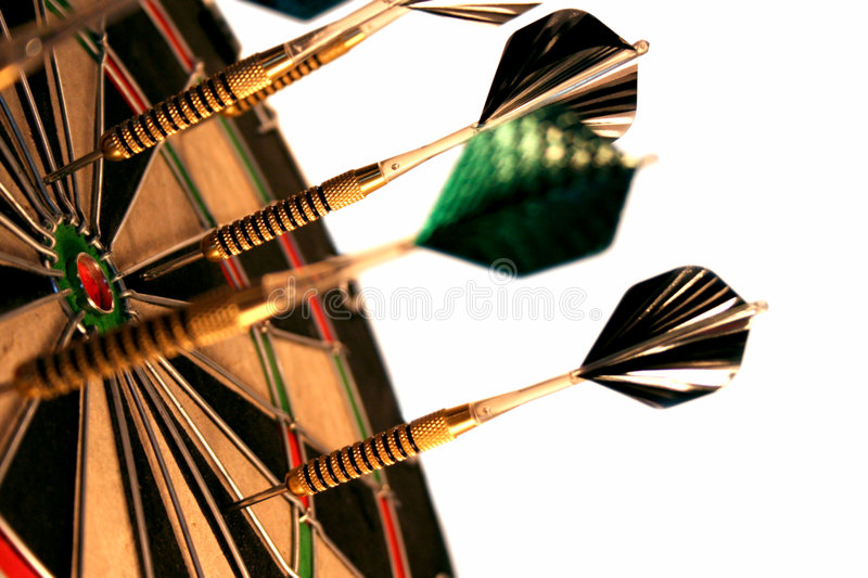 Darts. A close-up of darts in a dartboard against a white background stock photo