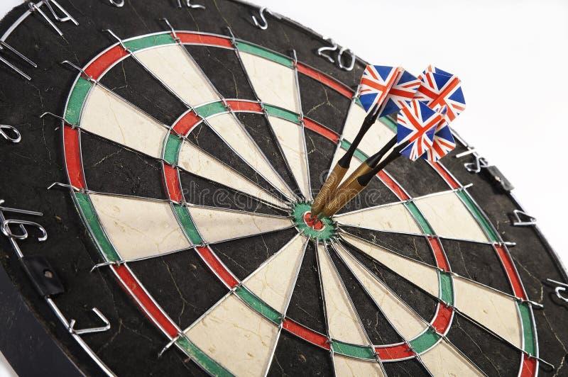 Darts. Centre dartboard darts entertainment fun game hit lunge mark on point put rush score spike spurt target throw win winning royalty free stock image
