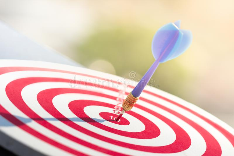 Darts arrow hitting in the target center of dartboard. concept business goal to marketing success. royalty free stock photos