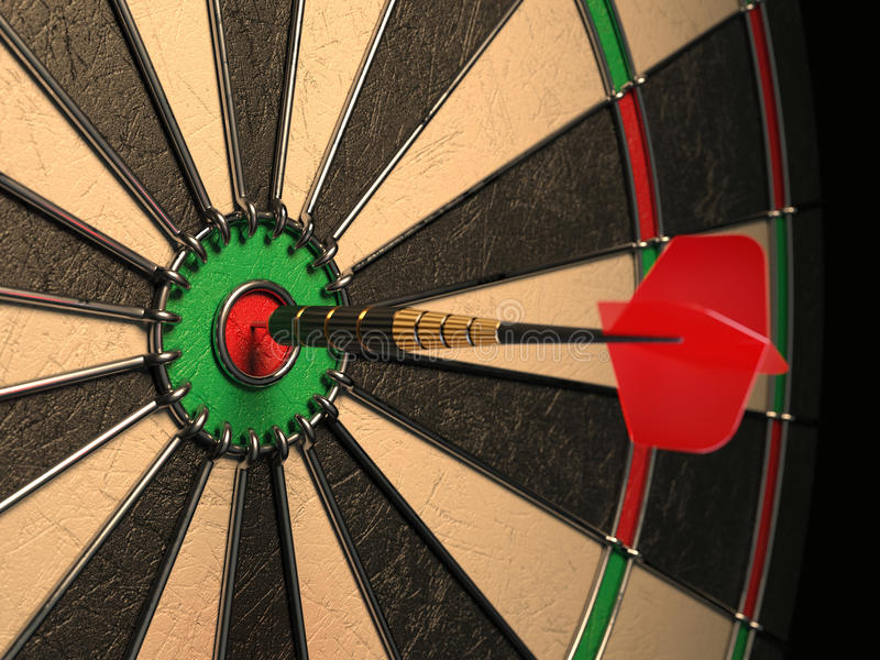 Darts arrow in the target center stock images