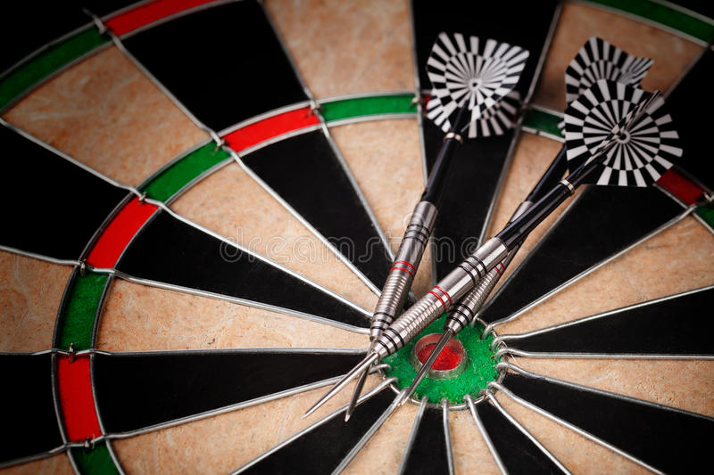 Darts. Arrows on the target royalty free stock images