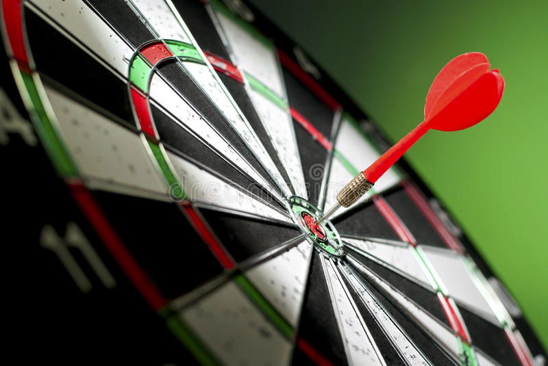 Darts arrows. In the target center stock images